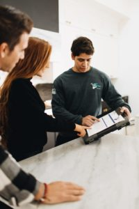 This image shows a Get Moving professional showing a customer the details of the moving contract.