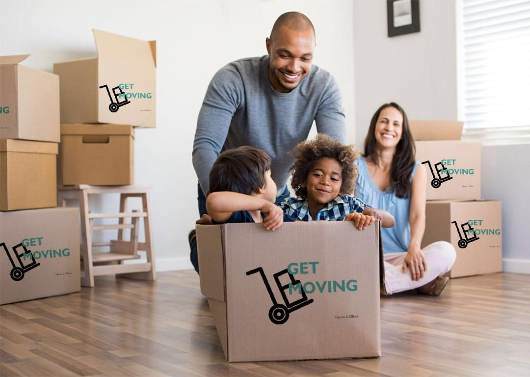 Image: a family surrounded by Get Moving boxes in their home.