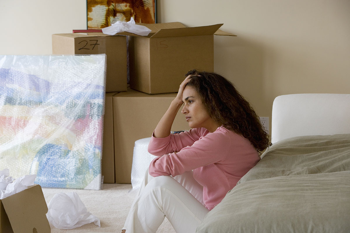 Image of a woman stressing on moving day