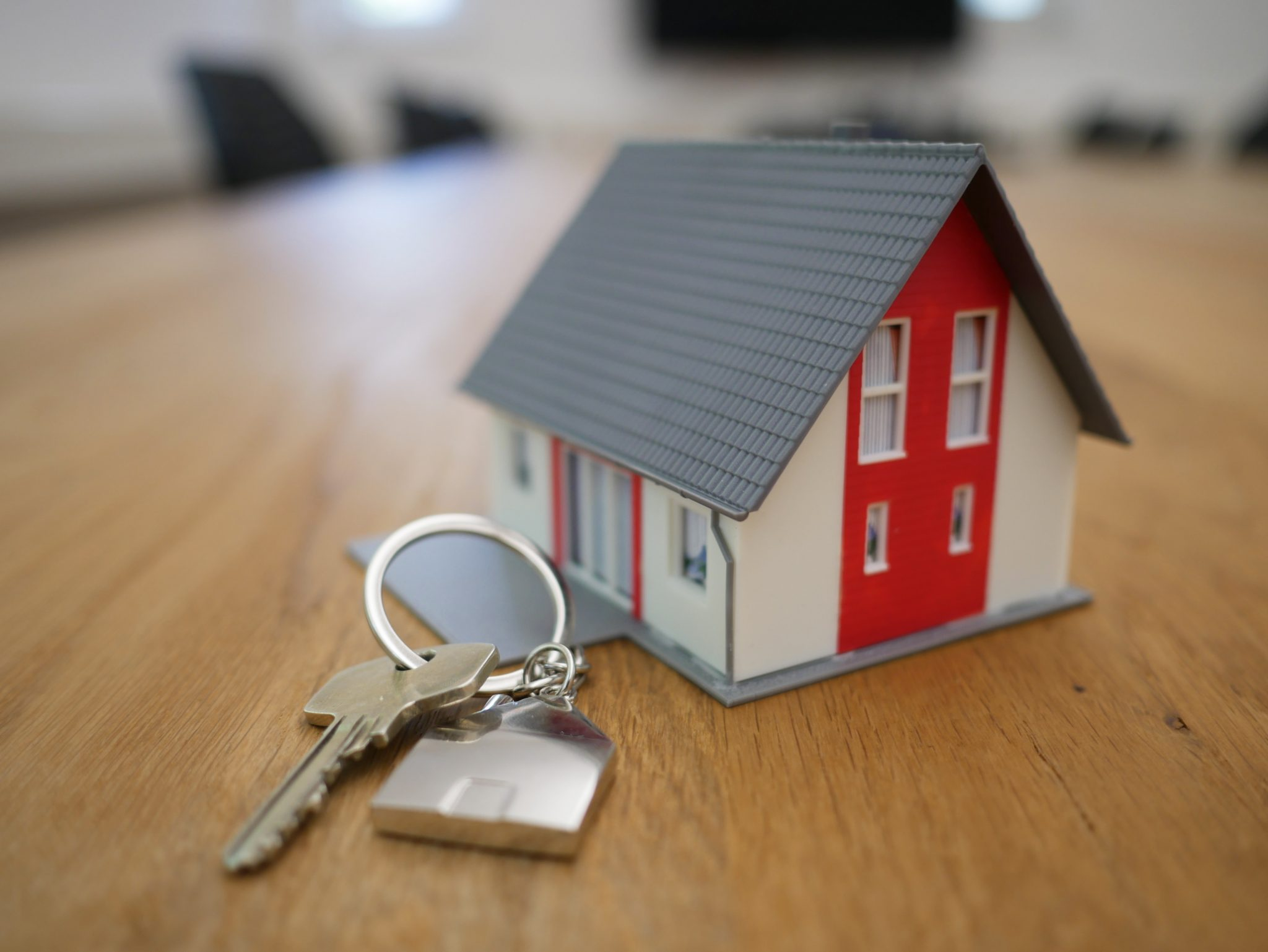 a keychain house with key on a table