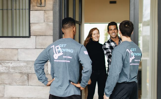 This image shows the Get Moving crew greeting customers.